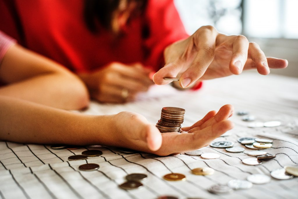 Photo by rawpixel.com from Pexels - Counting money